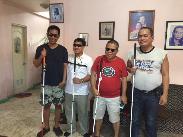 Rolando, Art, and two other men with their new canes!